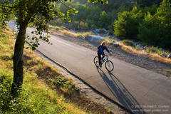 photo, picture, bicycle rider, bicyclist, late afternoon, West Fork National Scenic Bikeway Trail, San Gabriel River, San Gabriel Mountains, Angeles National Forest, California
