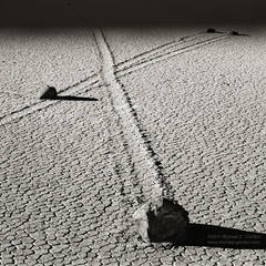 photo, picture, b/w, black and white, shadow, stones, moving, sailing, mysterious, tracks, trails, boulders, cracked, texture, light, Racetrack Playa, Death Valley