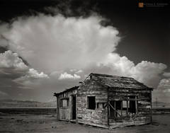 black and white,photo,picture,Mojave Desert,abandoned,historical,dwelling,shack,struture,cloud,monsoon,cumulonimbus,mountains,thunderstorm