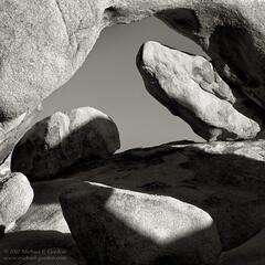 White Tank Arch, rocks, boulders, quartz monzonite, granite, shadows, Joshua Tree, Mojave Desert, black and white, fine art photograph, fine art print, photo, picture