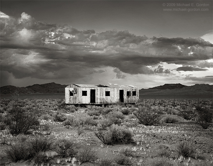American Dream, abandoned house, abandoned trailer, Mojave Desert, monsoon clouds, cumulus, mountains, black and white, fine art photograph, fine art print, photo, picture, photo