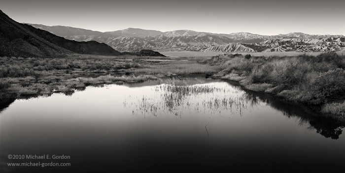 Death Valley, Mojave Desert, Saratoga Springs, pond, lake, tranquil water, calm, peaceful, light, oasis, Ibex Hills, badlands, Avawatz Mountains, sunrise, black and white, fine art photo, photo