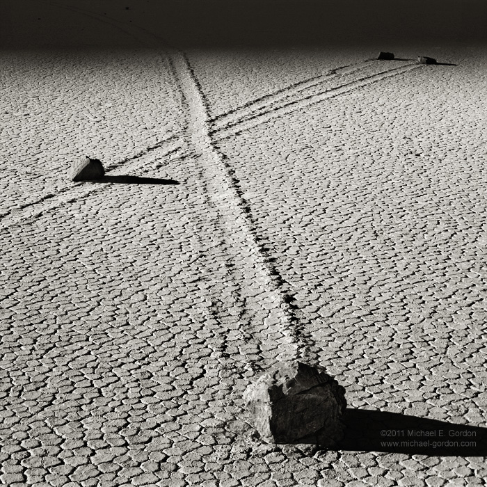 photo, picture, b/w, black and white, shadow, stones, moving, sailing, mysterious, tracks, trails, boulders, cracked, texture, light, Racetrack Playa, Death Valley, photo