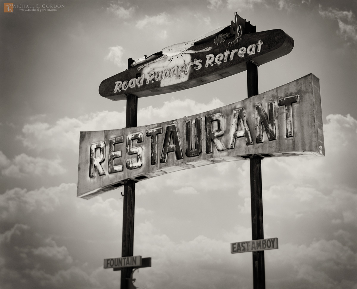 fine art photograph, black and white, b/w, photo, picture, Roadrunner's Reatreat, sign, clouds, cumulus, Route 66, East Amboy, California, large format, photo