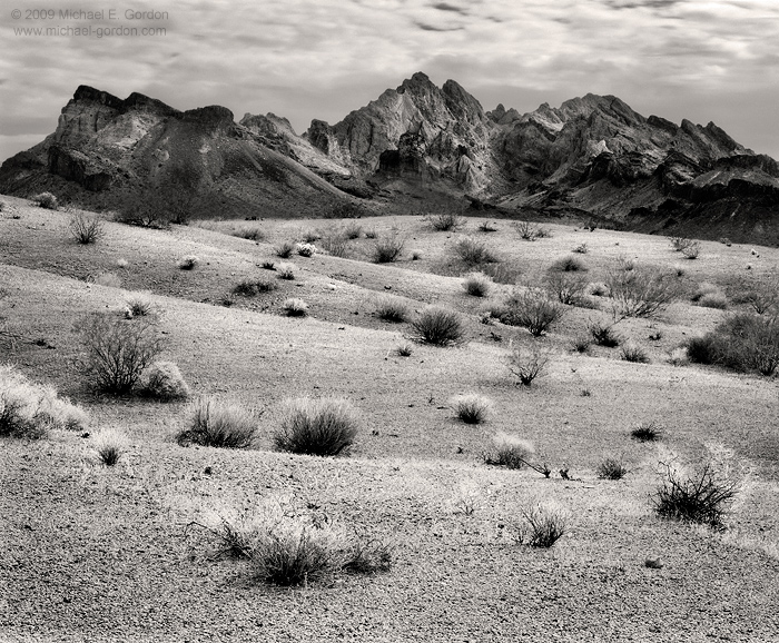 Turtle Mountains, Mojave Desert, clouds, shrubs, arid, black and white, fine art photograph, fine art print, photo, picture, photo