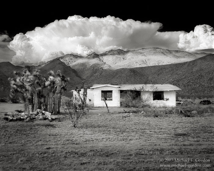 American Dream, abandoned house, Mojave Desert, Joshua Trees, monsoon clouds, cumulus, mountains, black and white, fine art photograph, fine art print, photo, picture, photo