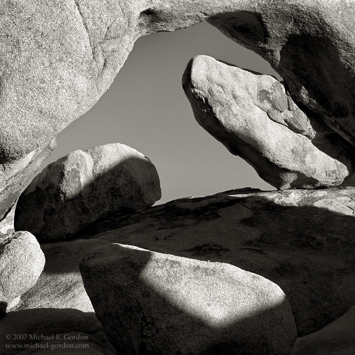 White Tank Arch, rocks, boulders, quartz monzonite, granite, shadows, Joshua Tree, Mojave Desert, black and white, fine art photograph, fine art print, photo, picture, photo