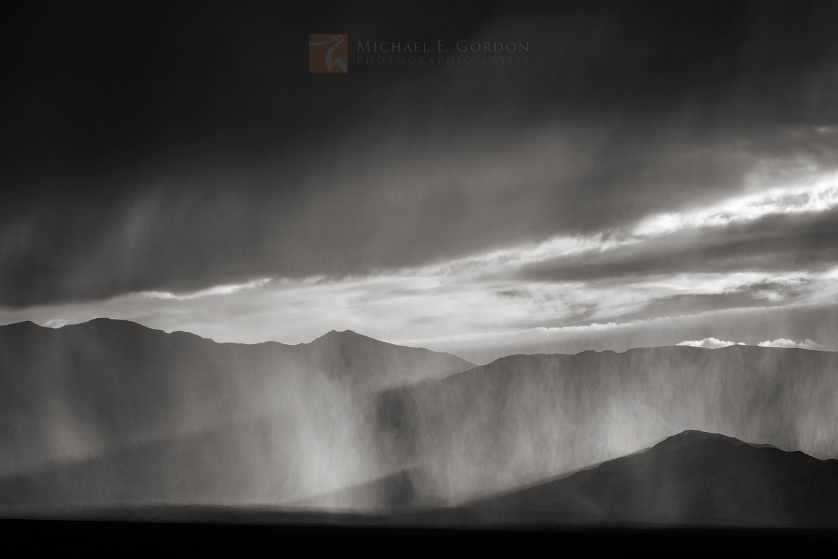 dramatic, back-lit, rain, clouds, shower, Cottonwood Mountains, Death Valley, photo