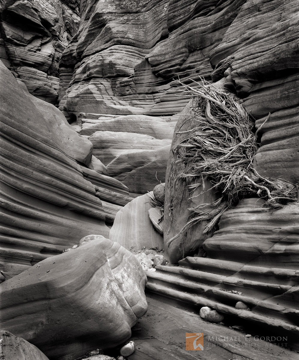 Flash flood, debris, packed, narrow, sandstone, grooves, boulders, slot canyon, Grand Staircase-Escalante, Utah, photo