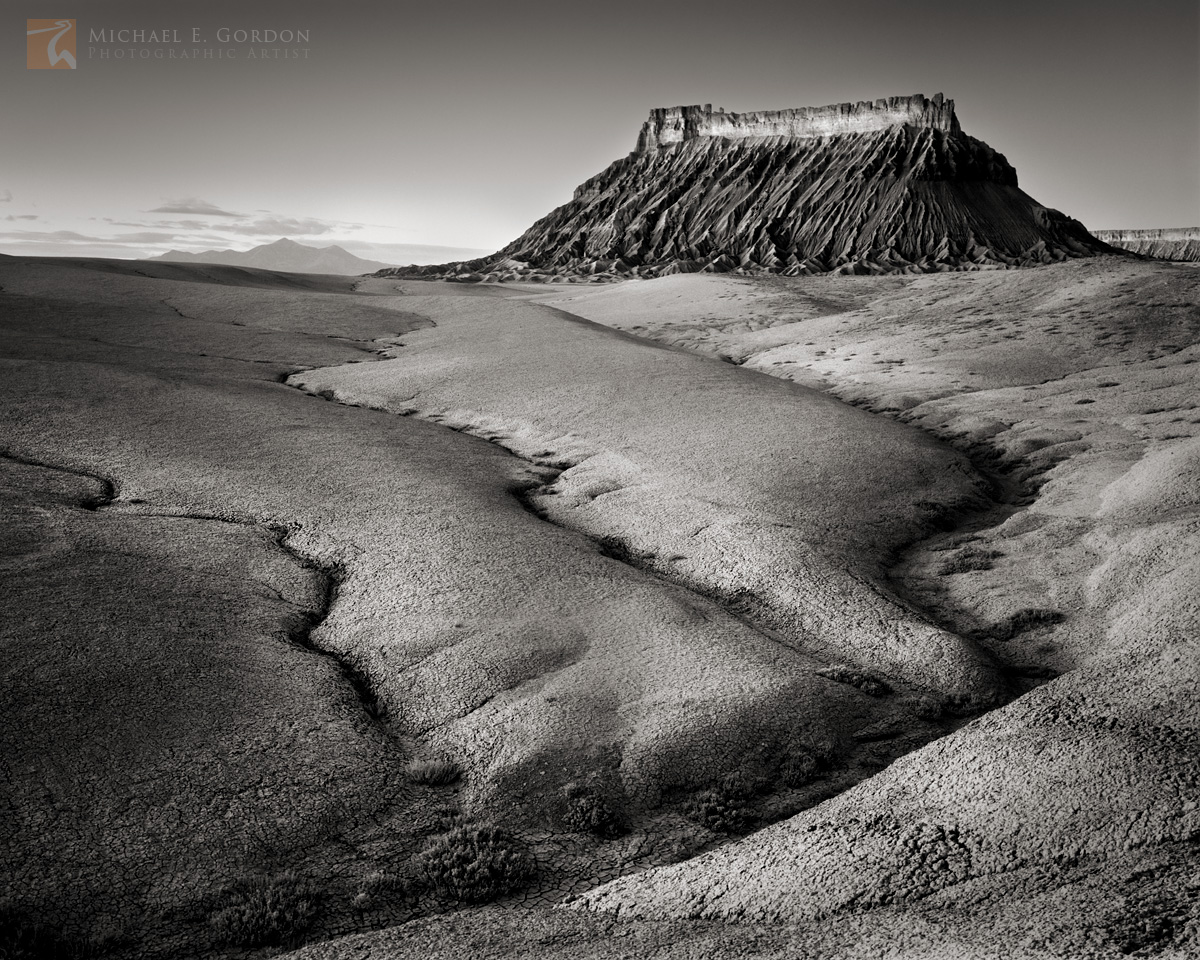 Sunrise, smooth, sculpted, eroded , Mancos Shale, badlands, Factory Butte., Henry Mountains, Utah, Caineville , photo