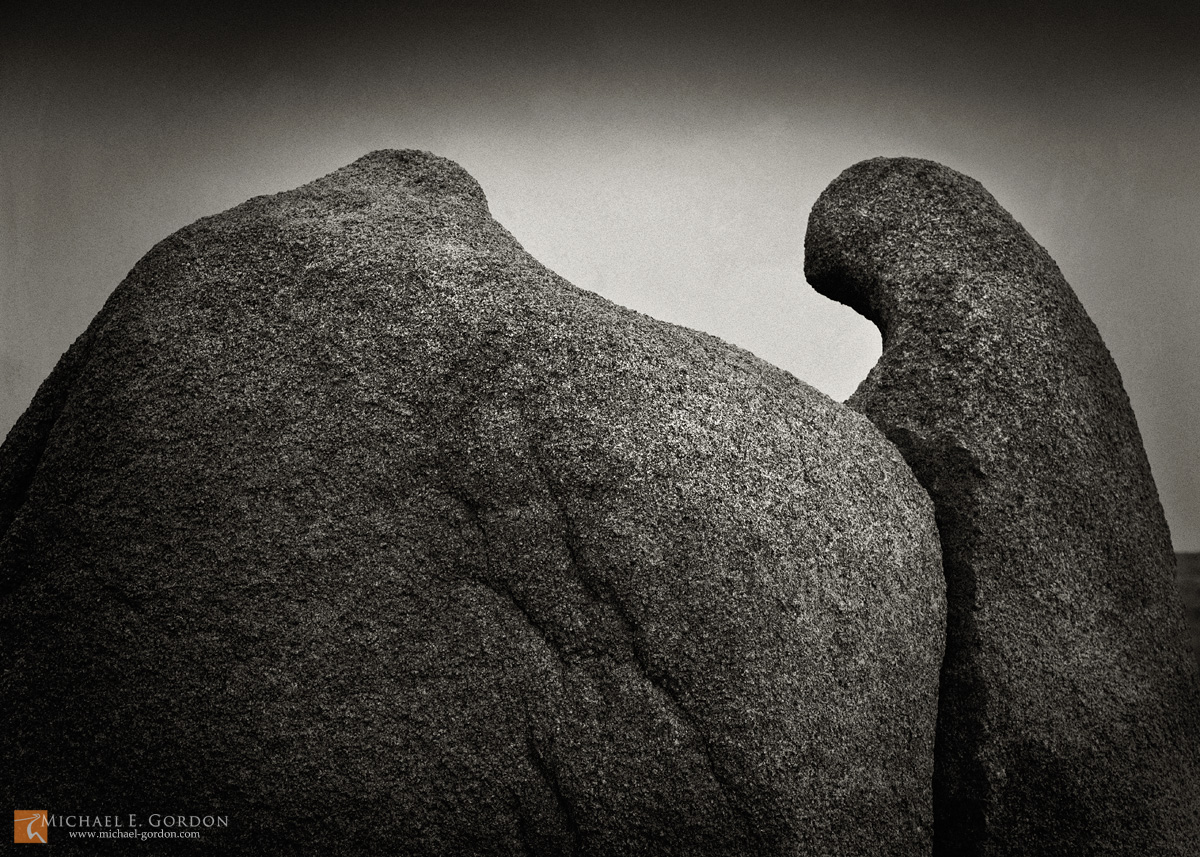 photo,picture,b/w,black and white,b&w,robe,hooded,figure,shaman,ghost,stone,quartz monzonite,boulder,formation,rock,metaphor,resemblance,spirit,Joshua Tree National Park,Jumbo Rock,b&w, photo