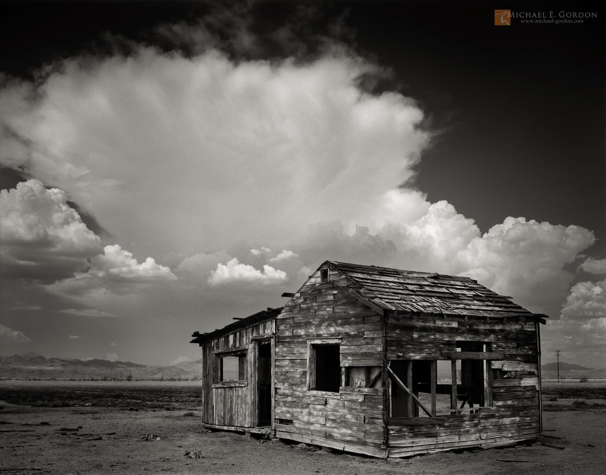 black and white,photo,picture,Mojave Desert,abandoned,historical,dwelling,shack,struture,cloud,monsoon,cumulonimbus,mountains,thunderstorm, photo