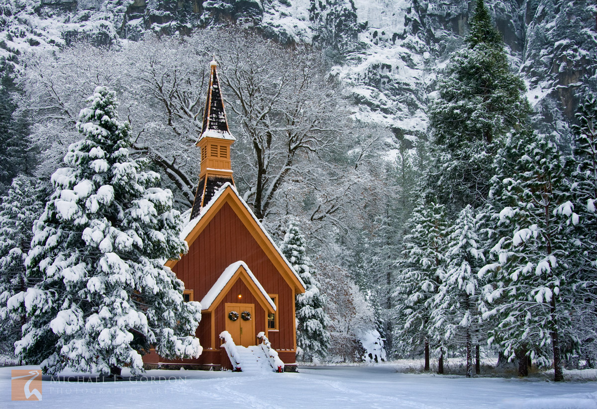 Yosemite Chapel during a winter snowstorm. Built in 1879, it is the oldest structure in Yosemite Valley.Logos and watermarks...
