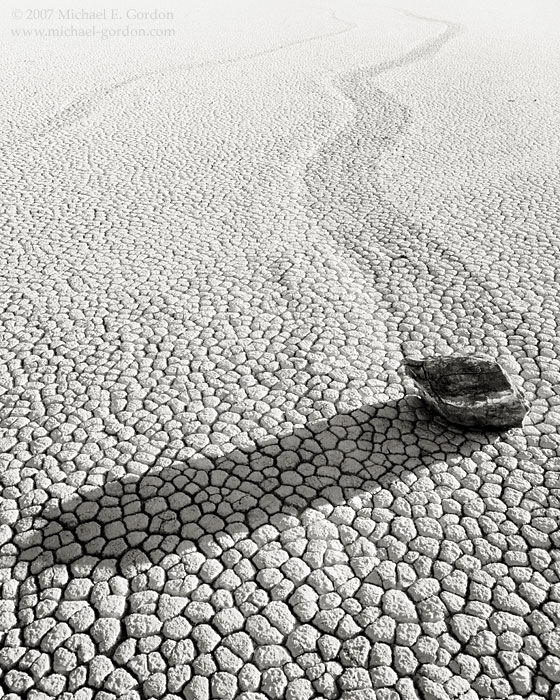 Racetrack, playa, moving rocks, cracked mud, Racetrack Valley, Death Valley, Mojave Desert, black and white, fine art photograph, fine art print, photo, picture, photo