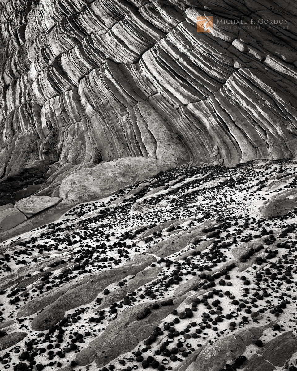 Natural Navajo sandstone and hematite concretionsknown as Moqui Marbles gather in sand-filled channels and flats....
